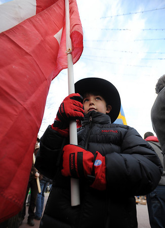 "Jonah Lefkoff, 7, leads the Swiss  mountain guides during the parade down Pearl Street on Sunday.<br /> The American Mountain Guides Association, based in Boulder, and the International Federation of Mountain Guides Association, had a joint meeting in Boulder. Over 300 members from 17 different countries attended.<br /> For more photos and a video of the parade, go to  <a href=""http://www.dailycamera.com"">http://www.dailycamera.com</a>.<br /> Cliff Grassmick / November 14, 2010"