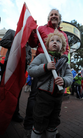 """Teagan Malcom, holds the Austrian flag with help from mountain guide, Hans Bergmann, during the Pearl Street parade on Sunday.<br /> The American Mountain Guides Association, based in Boulder, and the International Federation of Mountain Guides Association, had a joint meeting in Boulder. Over 300 members from 17 different countries attended.<br /> For more photos and a video of the parade, go to  <a href=""""http://www.dailycamera.com"""">http://www.dailycamera.com</a>.<br /> Cliff Grassmick / November 14, 2010"""