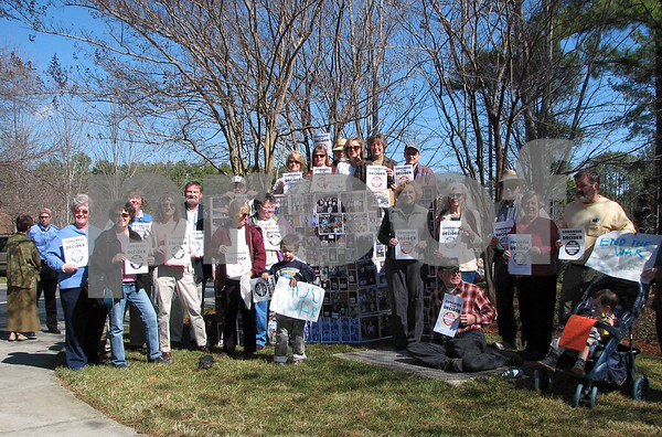 Enthusiastic MoveOn members gather for a rally at Representative David Price's office.