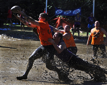 The Merrimack Mud Cats receiver gets his fingertips on the ball, during a Sept 10th. game, against the Carrabassett Valley Rats, during The 35th Annual World Championship of Mud Football, which was held September 9th thru 11th, 2011, on Steve Eastman Field at Hog Coliseum, in North Conway, New Hampshire.