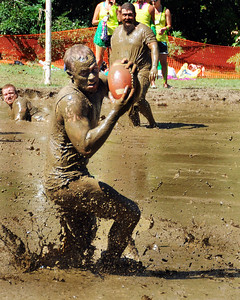 A Muddas Football Club receiver makes a catch early in a Sept 10th game against the MWV Hogs, during The 35th Annual World Championship of Mud Football, which was held September 9th thru 11th, 2011, on Steve Eastman Field at Hog Coliseum, in North Conway, New Hampshire.