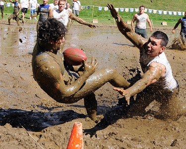 A MWV Hogs receiver attempts to catch a pass near the goal line, in a Sept 10th game vs the Muddas Football Club, during The 35th Annual World Championship of Mud Football, which was held September 9th thru 11th, 2011, on Steve Eastman Field at Hog Coliseum, in North Conway, New Hampshire.