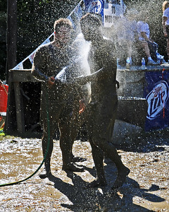 Two Cumberland (RI) Muckaneer players hose off mud, in a Sept. 10th game, during The 35th Annual World Championship of Mud Football, which was held September 9th thru 11th, 2011, on Steve Eastman Field at Hog Coliseum, in North Conway, New Hampshire.
