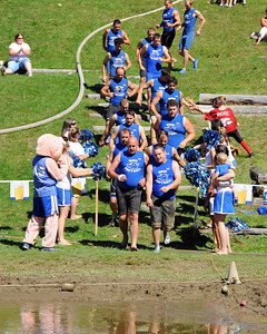 The MWV Hogs take the field on September 10th, 2011, for their game vs the Muddas Football Club, during The 35th Annual World Championship of Mud Football, which was held September 9th thru 11th, 2011, on Steve Eastman Field at Hog Coliseum, in North Conway, New Hampshire.