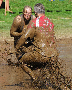 A Cumberland (RI) Muckaneer player looks to make a move around a Mud Skippers defender, in a Sept. 10th game, during The 35th Annual World Championship of Mud Football, which was held September 9th thru 11th, 2011, on Steve Eastman Field at Hog Coliseum, in North Conway, New Hampshire.