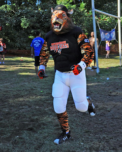 The Merrimack Mud Cats Mascot runs behind the endzone, in a Sept 10th. game, against the Carrabassett Valley Rats, during The 35th Annual World Championship of Mud Football, which was held September 9th thru 11th, 2011, on Steve Eastman Field at Hog Coliseum, in North Conway, New Hampshire.