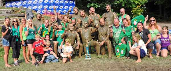 The Nashua Mud Gumbys and their Cheerleaders got together for a team photo, after winning The 35th Annual World Championship of Mud Football, as they defeated the Muddas Football Club, 12-10, on September 11th, 2011. The three day tournament, held Sept. 9th - 11th, included ten teams, playing on Steve Eastman Field at Hog Coliseum, in North Conway, New Hampshire,