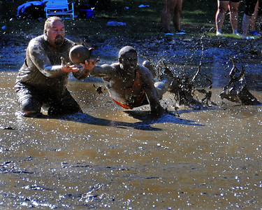 A Merrimack Mud Cats defender (right) tries to prevent a Carrabassett Valley Rat receiver from making a catch, in their Sept 10th. game, during The 35th Annual World Championship of Mud Football, which was held September 9th thru 11th, 2011, on Steve Eastman Field at Hog Coliseum, in North Conway, New Hampshire.