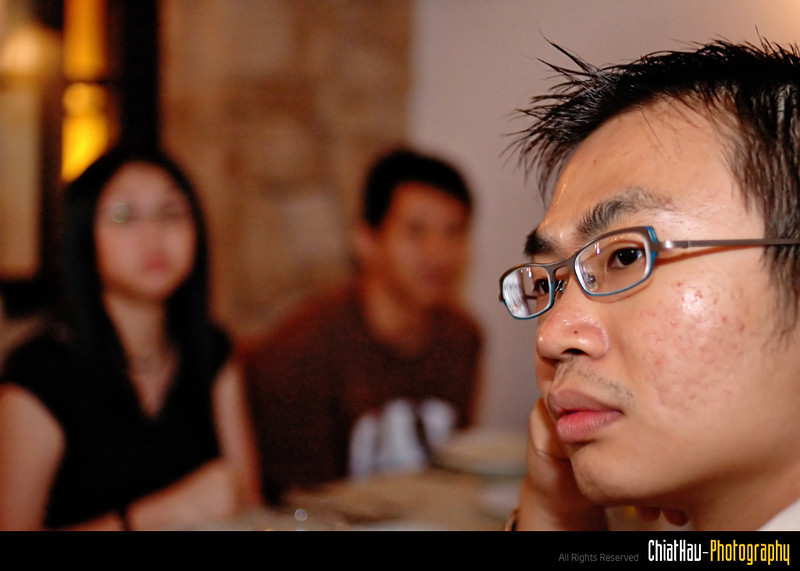 Ken-Horng is day dreaming while waiting for the food to be served.