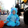 Maddox Brown, 3, dressed as Sully from Monsters, Inc., formed an attachment with Chip the CU mascot.<br /> Pearl Street Mall merchants provided treats to costumed munchkins on Sunday to celebrate the Downtown Boulder Munchkin Masquerade.<br /> Cliff Grassmick / November 1, 2009