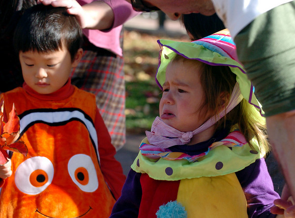 Portia Richards, 2, had a little spill that made her cry.<br /> Pearl Street Mall merchants provided treats to costumed munchkins on Sunday to celebrate the Downtown Boulder Munchkin Masquerade.<br /> Cliff Grassmick / November 1, 2009