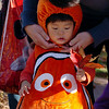 Kyo Abe gets fitted with his Nemo head for a family photo.<br /> Pearl Street Mall merchants provided treats to costumed munchkins on Sunday to celebrate the Downtown Boulder Munchkin Masquerade.<br /> Cliff Grassmick / November 1, 2009