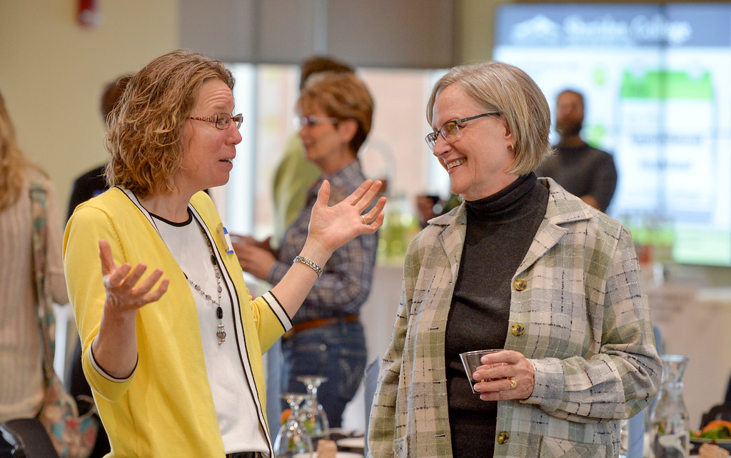 Justin Sheely | The Sheridan Press<br /> Janet Masters, left, and Laurie Walters-Clark visit during the 2017 FAB Women's Conference Friday at the Sheridan College Whitney Atrium. Tempe Murphy was named this year's Woman of the Year. Nominees Carrie Sisson, Sonja Caywood and Marta Ostler were honored at the event.