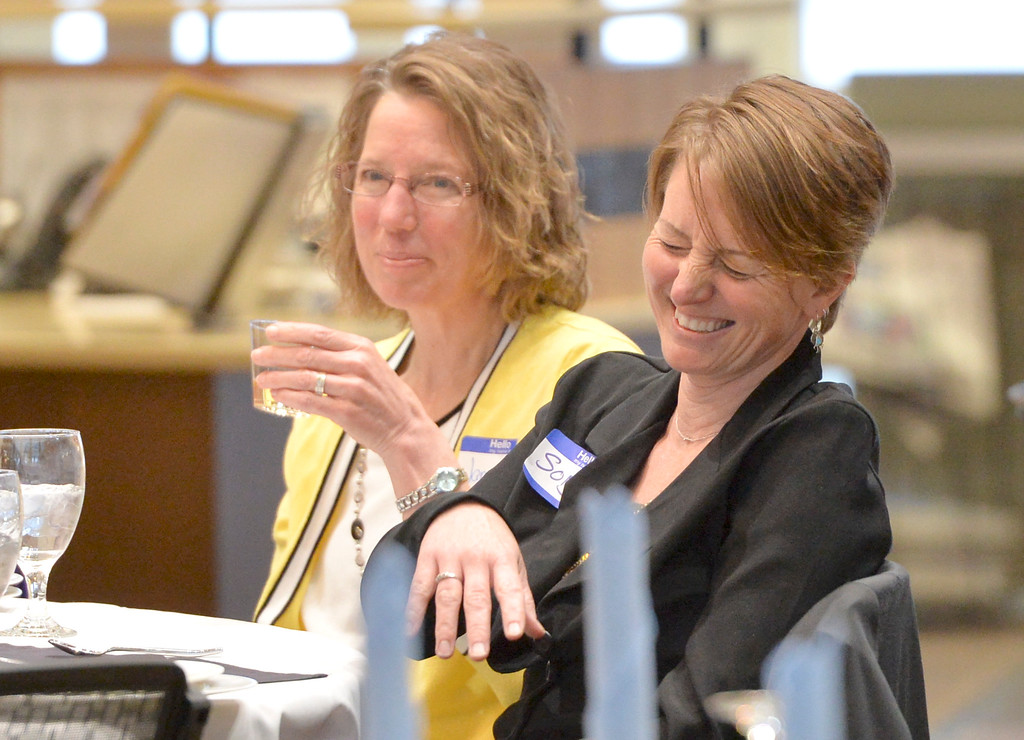Justin Sheely   The Sheridan Press<br /> Nominee Sonja Caywood reacts as a video interview about her nomination is shown at the dinner event during the 2017 FAB Women's Conference Friday at the Sheridan College Whitney Atrium. Tempe Murphy was named this year's Woman of the Year. Nominees Carrie Sisson, Sonja Caywood and Marta Ostler were honored at the event.