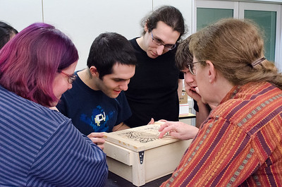 Writing team members seeing the treasure chest for the first time.