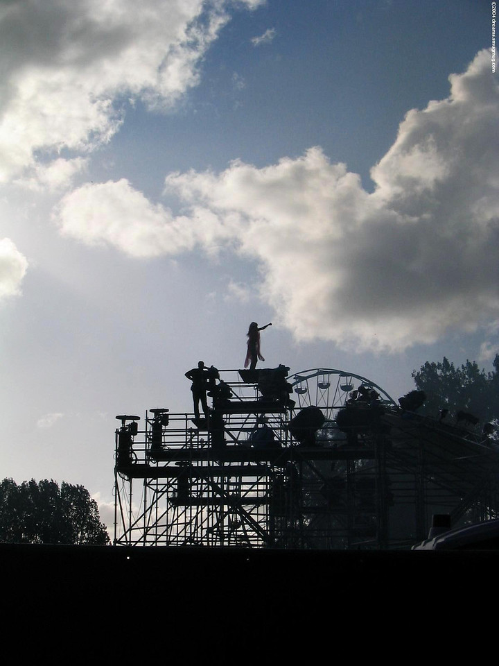 MC at the main stage, standing on top of scaffolding against the light