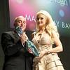 Bruce Selan presenting Holly Madison with the 2011 NAHA Beautiful Humanitarian Award.