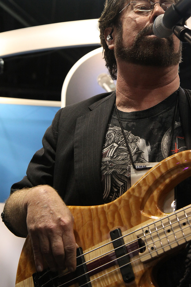 Ron Lutrick playing bass with Johnny Hiland at Lectrosonics booth.