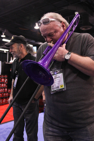 John Ervin blow the sh*t out of a plastic trombone.  My old friend Bob Scarff is in the background.