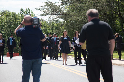 Video cameraman walking backwards as procession starts (Goddard Center Director Chris Scolese in red tie). --King Carl XVI Gustaf of Sweden visited NASA/Goddard on May 3, 2017.  These photos show his short walking procession from viewing the Hyperwall in Building 28 to the clean room facility in Building 29.