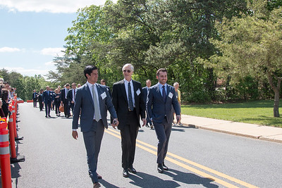 Dr. John Mather (center), 2006 Nobel Laureate in Physics, was part of the procession, having met the King at the Dec 2006 Nobel ceremony and dinner. -- King Carl XVI Gustaf of Sweden visited NASA/Goddard on May 3, 2017.  These photos show his short walking procession from viewing the Hyperwall in Building 28 to the clean room facility in Building 29.