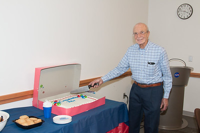 Peter cuts the cake -- Retirement party for Peter Serlemitsos from NASA/GSFC after 55 years. -- April 27, 2017 -- NASA/Goddard Space Flight Center, Greenbelt, MD