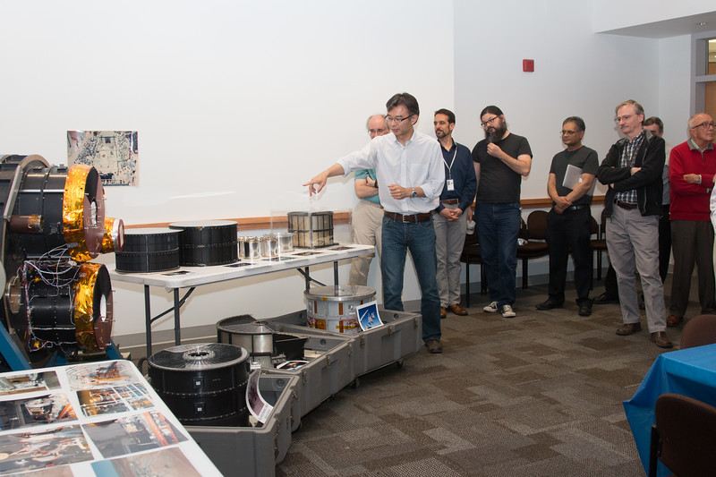 Takashi Okajima gives a tour of each of the X-ray mirrors on display -- Retirement party for Peter Serlemitsos from NASA/GSFC after 55 years. -- April 27, 2017 -- NASA/Goddard Space Flight Center, Greenbelt, MD
