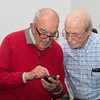Tom Cline shows Peter something on his iPhone -- Retirement party for Peter Serlemitsos from NASA/GSFC after 55 years. -- April 27, 2017 -- NASA/Goddard Space Flight Center, Greenbelt, MD