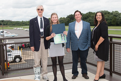 "Awardee Jillian Kunze with John Mather, Eric Day (National Space Grant Foundation), and Raquel Marshall (NASA/GSFC Education Office) -- An award luncheon, ""Dr. John Mather Nobel Scholars Program Award"", as part of the National Space Grant Foundation. College Park Aviation Museum, College Park, MD, August 3, 2018."