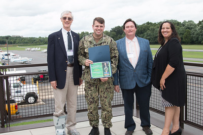 "Awardee Joel Chapman with John Mather, Eric Day (National Space Grant Foundation), and Raquel Marshall (NASA/GSFC Education Office) -- An award luncheon, ""Dr. John Mather Nobel Scholars Program Award"", as part of the National Space Grant Foundation. College Park Aviation Museum, College Park, MD, August 3, 2018."