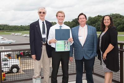 "Awardee Tyler McCabe with John Mather, Eric Day (National Space Grant Foundation), and Raquel Marshall (NASA/GSFC Education Office) -- An award luncheon, ""Dr. John Mather Nobel Scholars Program Award"", as part of the National Space Grant Foundation. College Park Aviation Museum, College Park, MD, August 3, 2018."