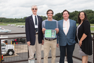 "Awardee Mark Moretto with John Mather, Eric Day (National Space Grant Foundation), and Raquel Marshall (NASA/GSFC Education Office) -- An award luncheon, ""Dr. John Mather Nobel Scholars Program Award"", as part of the National Space Grant Foundation. College Park Aviation Museum, College Park, MD, August 3, 2018."