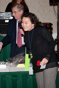 Jennifer Wei, a door prize winner, picks out the ticket for the next winner -- ADNET Systems 2011 Holiday Awards Party