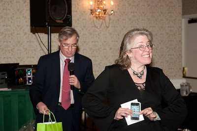Michele Smith, accepting on behalf of her sister, Jeanne Beatty -- ADNET Systems 2011 Holiday Awards Party