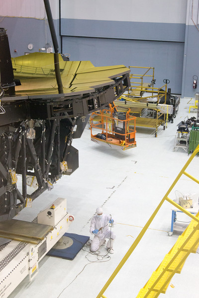 A worked inspects cables for the hovercraft feet -- James Webb Space Telescope -- the uncovering of the assembled primary mirror was completed today (April 26, 2016), Bldg 29 cleanroom, NASA/Goddard Space Flight Center