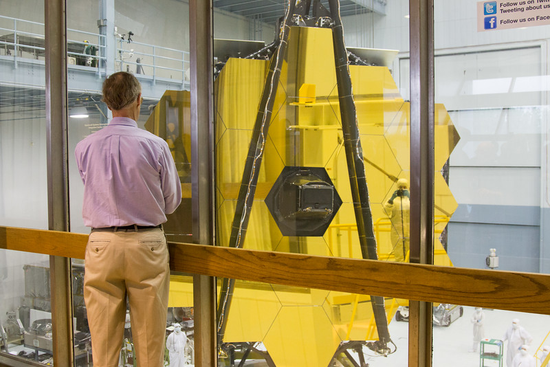 John Mather, Project Scientist for JWST, faces the James Webb Space Telescope primary mirror, NASA/Goddard Space Flight Center, Greenbelt, MD, May 4, 2016