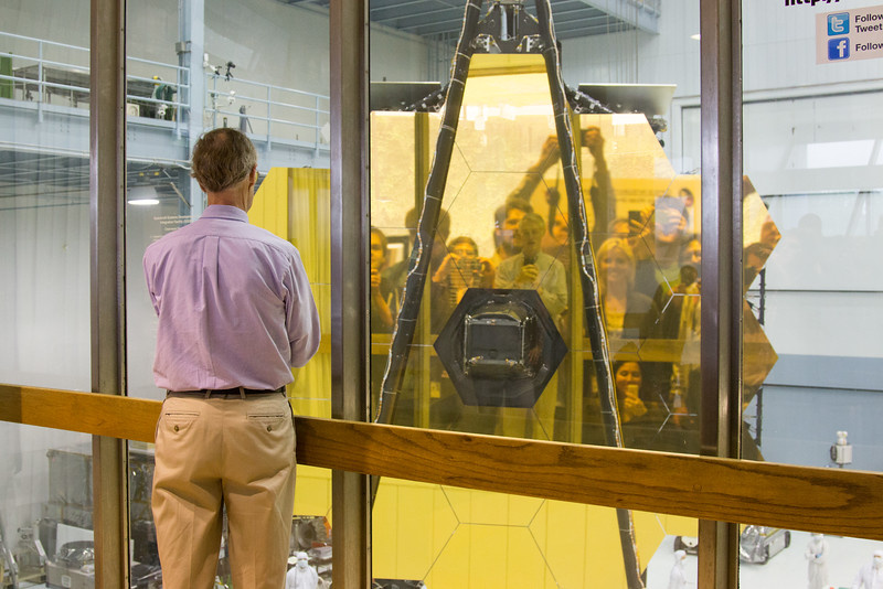 John Mather, Project Scientist for JWST, faces the James Webb Space Telescope primary mirror, taking a selfie, NASA/Goddard Space Flight Center, Greenbelt, MD, May 4, 2016