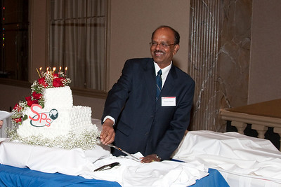 Swami Reddy prepares to cut the 10th anniversary cake -- SP Systems, Inc Fourth Annual Business Meeting & Luncheon, Greenbelt, MD