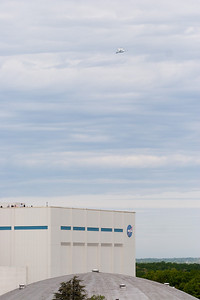 The Shuttle files above Bldg 29, the huge cleanroom. --  On April 17, 2012, the Space Shuttle Discovery was flown to Air & Space Museum's Udvar-Hazy Center in Virginia aboard the NASA 747 Shuttle Carrier Aircraft (SCA).  The SCA flew over NASA/Goddard, and *directly* over Building 34, where a crowd of us were on the roof.