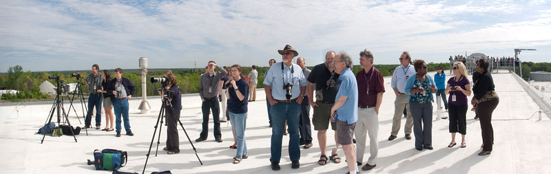 A crowd atop Building 34 at NASA/Goddard Space Flight Center looks west for the Space Shuttle Discovery and the NASA 747 Shuttle Carrier Aircraft.  Just a few minutes after this shot, the SCA arrived from the southeast (to the right in this photo), and flew directly overhead.  My camera for the SCA/Discovery sequence is on the tripod in the foreground.