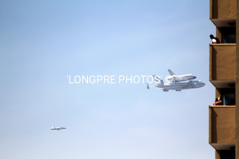 ENDEAVOUR and 747 about to disappear behind this Long Beach building.