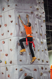 Kendric (age 12) from Temple Hills MD tries the DARCARS rock climbing wall.