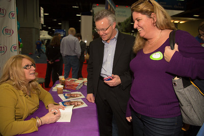 Popular radio personality Delilah signs an autograph for Cathy Daum of Sterling VA.