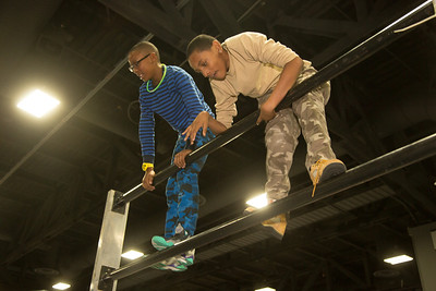 Demonte and Chris (both age 12) try the Civilian Military Combine Extreme Challenge Course.