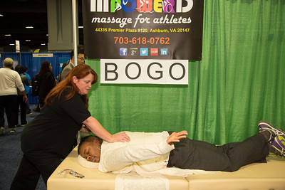 Holly Patterson of MpowerD massage for athletes of Ashburn VA provides free massage service to Terri Robinson of D.C.