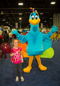 Charlotte from Arlington VA poses with the NBC Peacock.