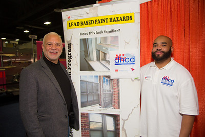 Michael P. Kelly (Director) and Dante Blackston (Project Manager) of the Government of the District of Columbia Department of Housing and Community Development.