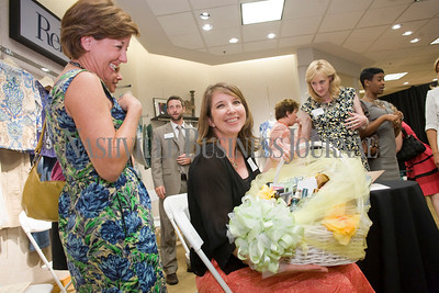 Mary Beth Ikard, center Janet Walls, left   Women of Influence Reunion at Dillards department store, Cool Springs  photo by James Yates