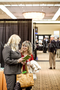 "LaQuita Scaife, left, talks with business partner at Health4Life Center Vanessa Gregory during the Nashville Business Journal's first Business Growth Expo at the Nashville Convention Center Wednesday.  ""You can be doing a wonderful thing but if no one knows you exist, how good are you really,"" said Gregory. More than 40 businesses were represented. Nathan Morgan 