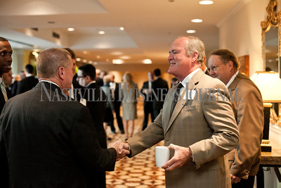 """Tom Copeland, right, of Traders Bank introduces himself to Kent Cleaver, left,  of Avenue Bank Thursday during the Nashville Business Journal's """"Banking's New Chessboard"""" panel discussion. The discussion was sponsored by KPMG at Loews Vanderbilt Hotel Nashville. Nathan Morgan 